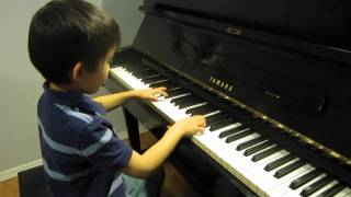 Alex 6 plays piano Angry Birds Theme Song