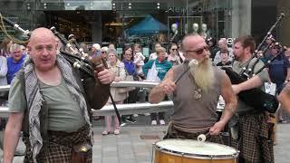 "Wild men of Scottish street music Clanadonia playing ""Hamsterheid"" in Perth City centre, Scotland"