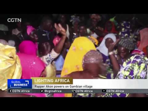 Rapper Akon powers on Gambian village