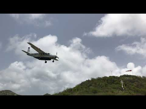 Cessna Caravan is landing at St. Barts...One of the most dangerous airports of the World...