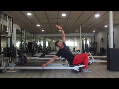 Ejercicio en el reformer para estabilizar la cintura escapular