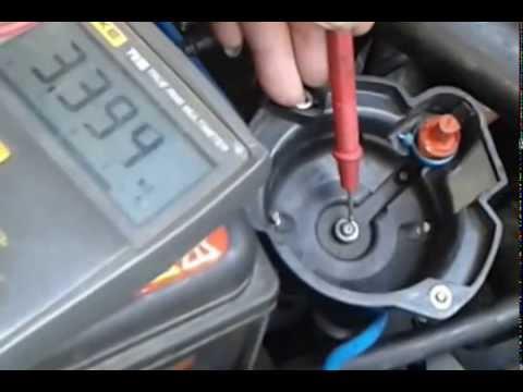 Testing Carbon Brush Rotor Contact Of Distributor Cap