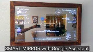 Smart Mirror with AI using Raspberry Pi plays youtube, news, controls nest, smart light etc.