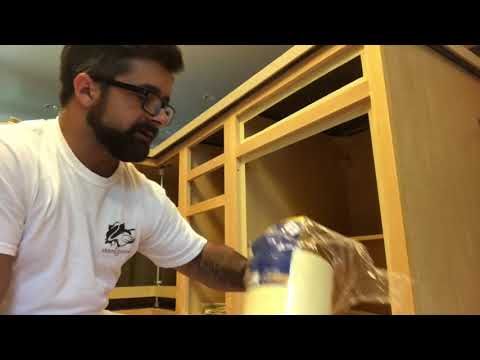 how-to-refinish-kitchen-cabinets-part-3-sanding-and-masking-cabinet-bases