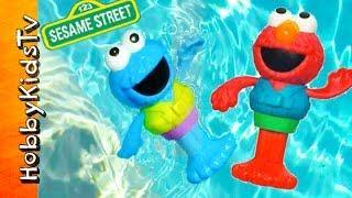 Cookie Monster + Elmo Swimmers! Pool Dives Race Sesame Street Toys by HobbyKidsTV