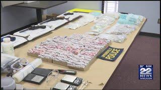 2 kilos heroin, 40K heroin bags, cocaine, firearms, $48K seized from Springfield home