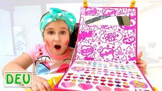 Anya spielt mit Make-up für Mädchen