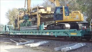 Union Pacific Railroad Tie Train unloading concrete ties in Dixon IL HD