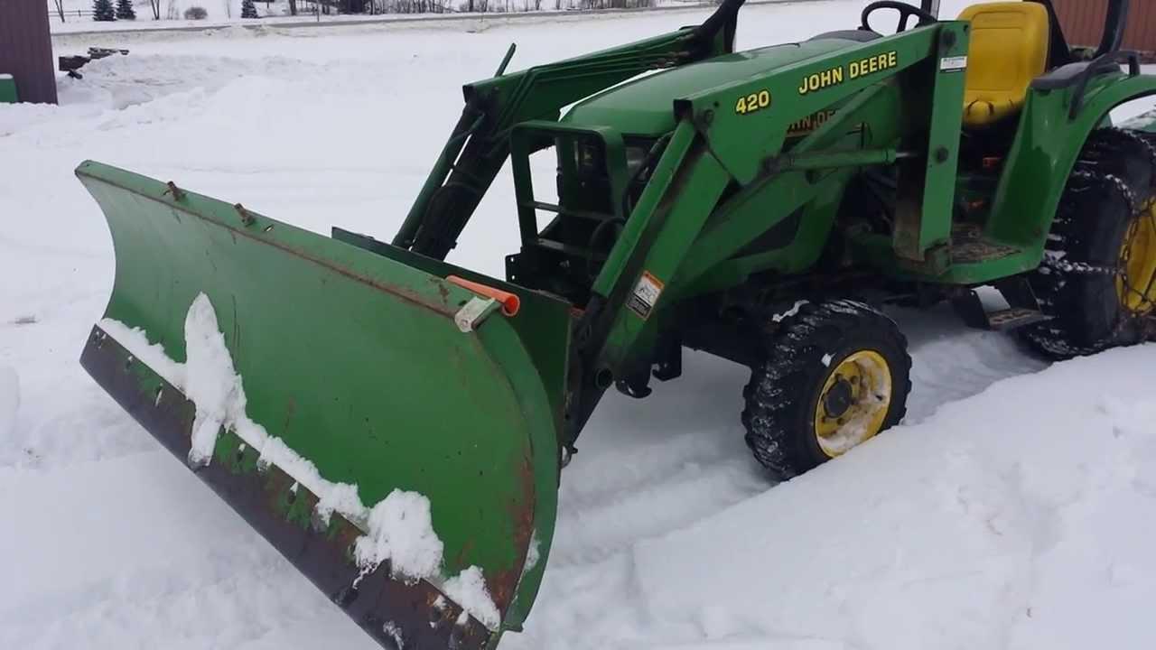 John Deere Snow Plow : John deere pushing snow youtube