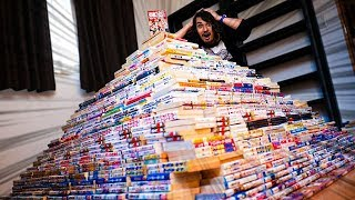 I Made a GIANT Pyramid out of 10,000 Manga ($50,000 CHALLENGE)