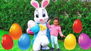 Leah and Anwar pretend play Easter Surprise Eggs Hunt & Open Toys