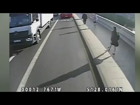 American denies being jogger who pushed woman into traffic