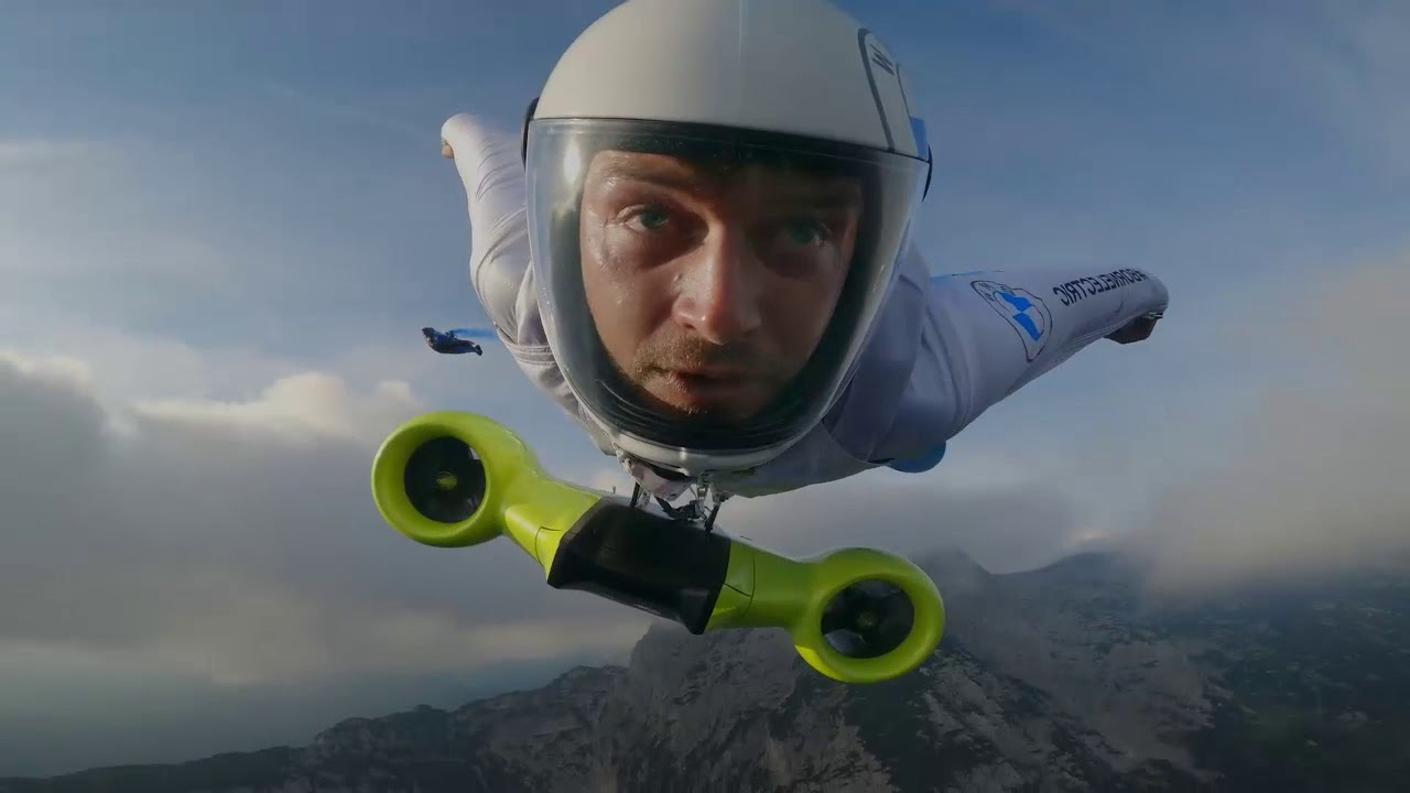 Electric mobility in new spheres: The first electrified wingsuit flight,  powered by BMW i