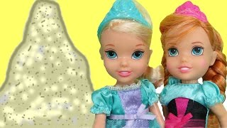 ELSA's SANDCASTLE ! Elsa and Anna toddlers have fun playing with sand