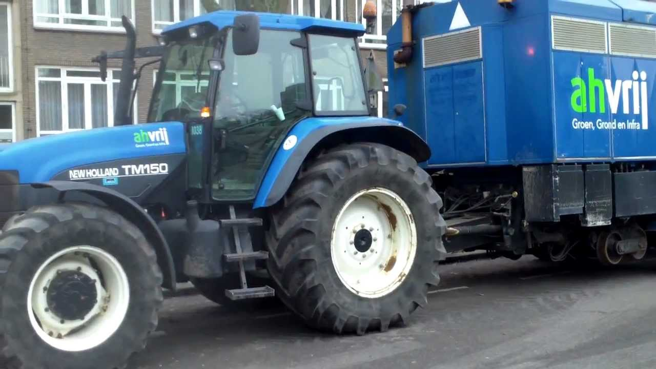 New Holland TM 150 tractor + huge vacuumcleaner , to save tree roots