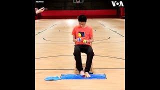 Thiếu niên TQ phá kỷ lục giải Rubik bằng tứ chi (VOA)
