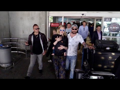EXCLUSIVE : Julia Stiles and baby and husband arriving in Cannes
