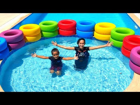 Esma and Asya pool game play with colored wheels for kids video