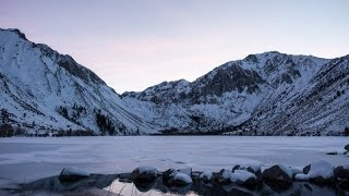 Sunset at ice covered Convict Lake near Mammoth Lakes, California
