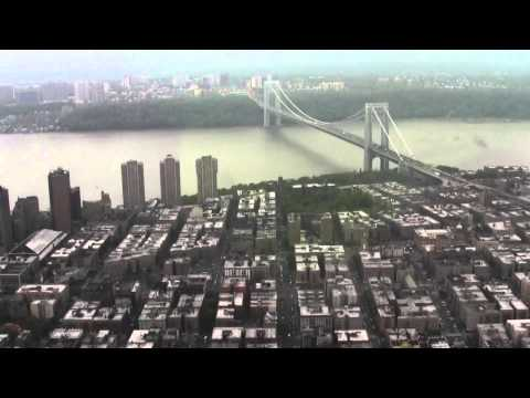 Helicopter flight around a windy, rainy, and cloudy New York City