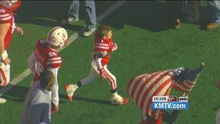 Norfolk boy leads team onto field as a Husker