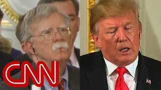 Bolton looks on as Trump undercuts him in public