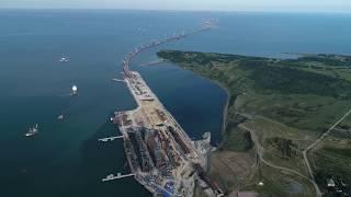 Керченский мост (Крымский мост) со стороны Крыма, арка моста. Аэросъемка квадрокоптером 4к 60fps