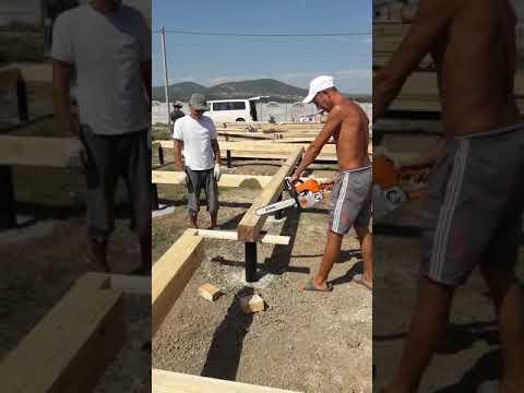 Монтаж обвязочного бруса под каркасный дом на свайном фундаменте