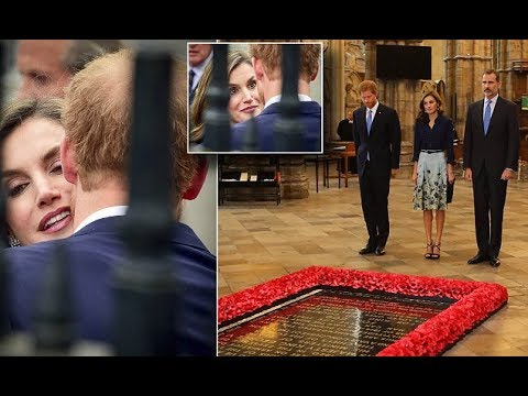 Prince Harry greets the Spanish Queen with a kiss on the cheek at outside Westminster Abbey today