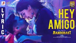 Bandobast - Hey Amigo Lyric | Suriya | Harris Jayaraj | K.V. Anand