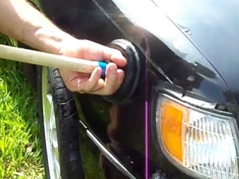 Dent removal (attempted) with a toilet plunger