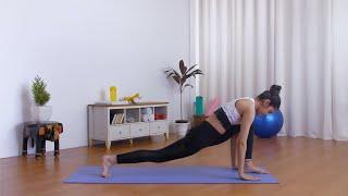 Flexible Indian female practicing Anjaneyasana (low lunge pose) on a yoga mat