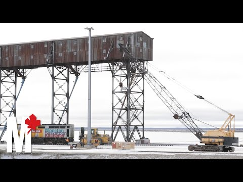 Giant cranes lift stranded Via Rail cars as Churchill struggles without rail line