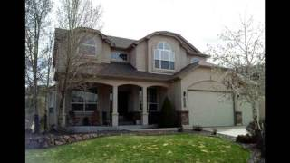 Trim Painting On Two Stucco Homes - New Overhead Doors - Front Range Exteriors Colorado Springs