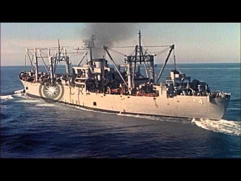 USS Mount Baker approaches USS Coral Sea and ammunition being lifted from ship de...HD Stock Footage