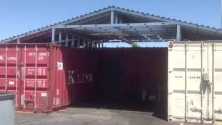 Steel Metal roof over two Shipping Containers