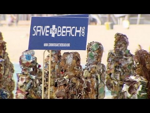 'Trash People' statues parade in Barcelona to highlight sea litter