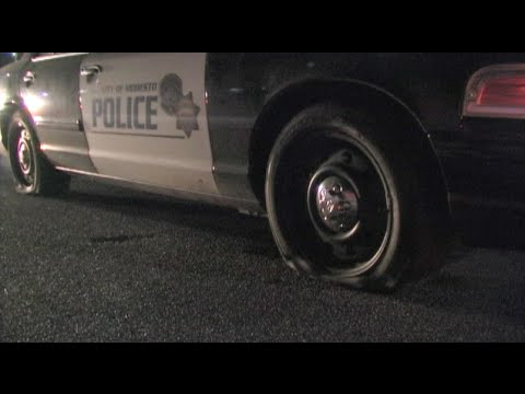 Police Cars Damaged By Spike Strips During Police Chase In Modesto, California