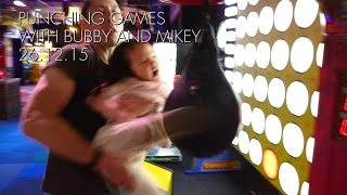 little girl kicking the punching machine arcade game