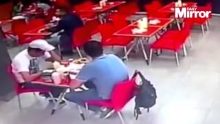 Police release shocking video of man shot in back of head as he dined at fast food restaurant
