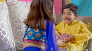 Raksha Bandhan - Cute little Indian brother teasing his sister for her rakhi gift