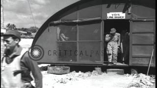 US air crewmen boards US PB4Y Liberator patrol bomber aircraft parked on an airfi...HD Stock Footage