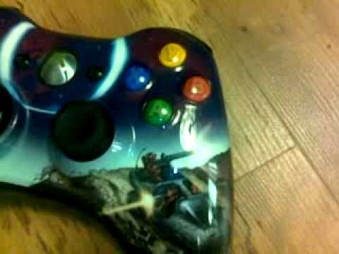 How do you clean a button on a Xbox 360 controller?