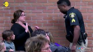 US teacher handcuffed by officer at school board meeting