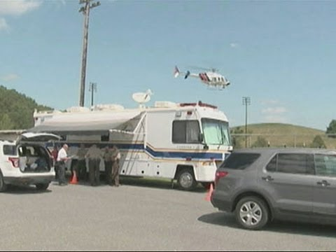 Raw: Emergency Crews Arrive at Jet Crash Scene