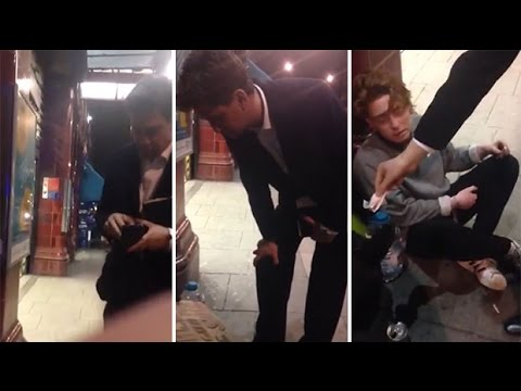 Ed Miliband filmed giving homeless man £10 at teens