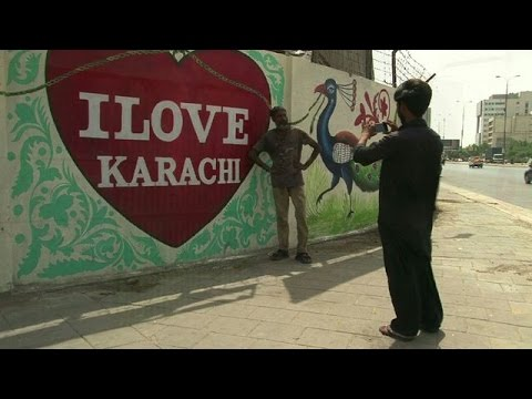 Karachi artists reclaim city walls from hate graffiti