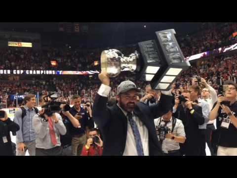 Griffins coach Todd Nelson raises Calder Cup Trophy