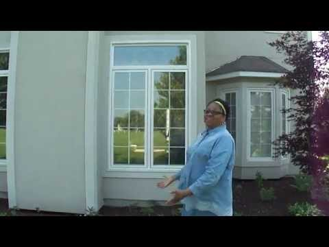 Homeowner Shows Her New Windows Installed by Opal Enterprises in Naperville