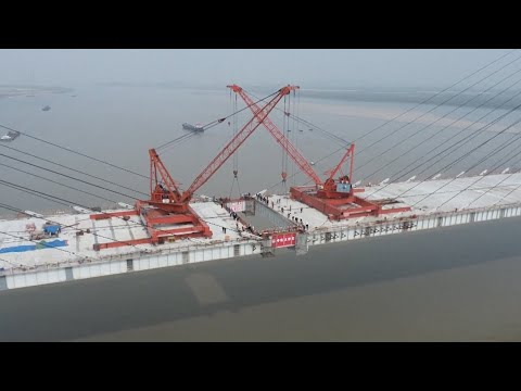 World's longest steel-concrete, composite cable-stayed bridge joined together over Yangtze River